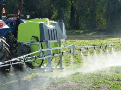 TTI Linkage Boom Spray on back of tractor chemical spraying from boom onto field in Australia